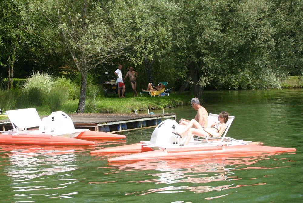 A pedal boat or pedalo for adventures on the water in the pond, in the Les Etangs du Bos leisure park