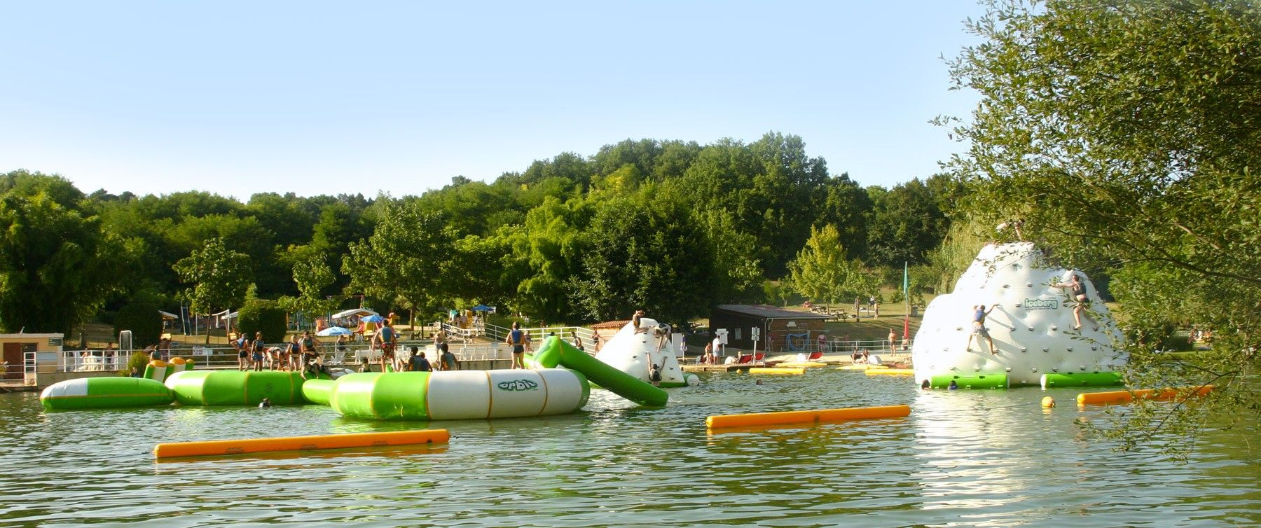 a water park with water inflatables on the pond in Périgord Noir