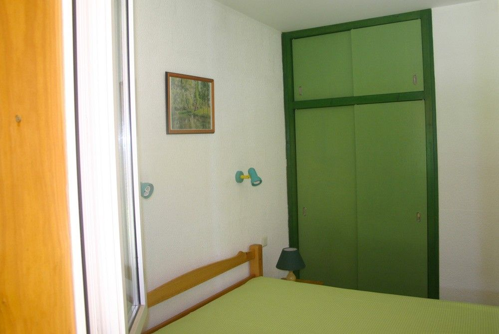 Bedroom with double bed and cupboard, more spacious than the caravans